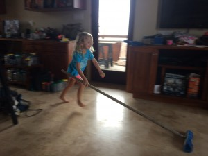 Our daughter helping with the clean up. The day we could go barefoot in the house again was a big milestone!