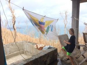 Our son stringing up the flag that used to hang in their room and was found in our neighbor's yard after the storm. Nothing can take away our love for this place!
